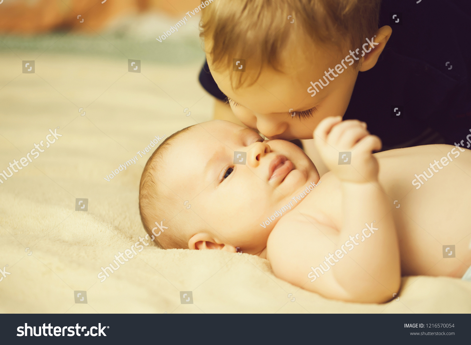 78e625707 Little Naked Baby Lying On Bed Stock Photo (Edit Now) 1216570054 ...