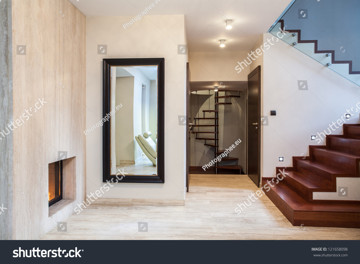 travertine house: huge mirror and wooden stairs stock photo