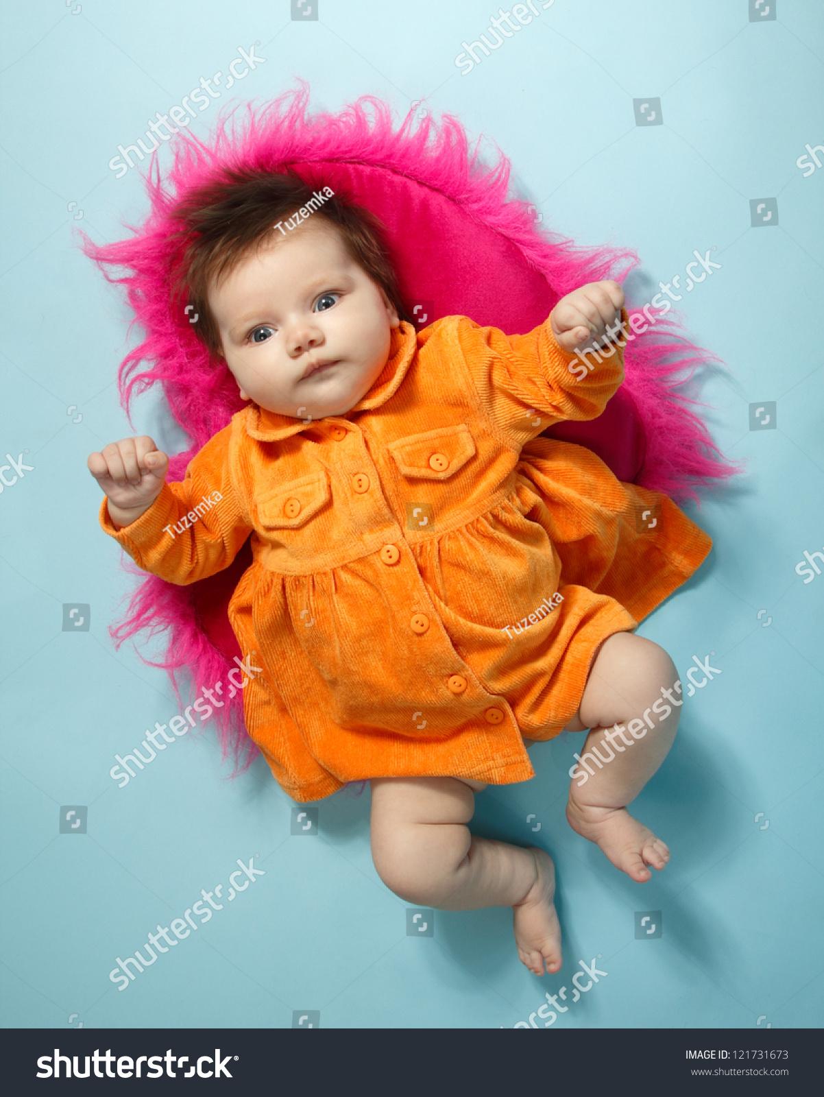 cute baby girl in orange dress