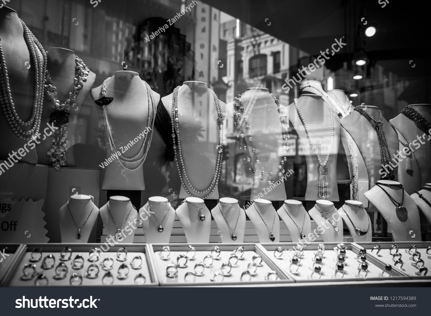 0a76a5eac3 Black and White Picture of a Display of pearl necklaces and rings in a  jewelry shop