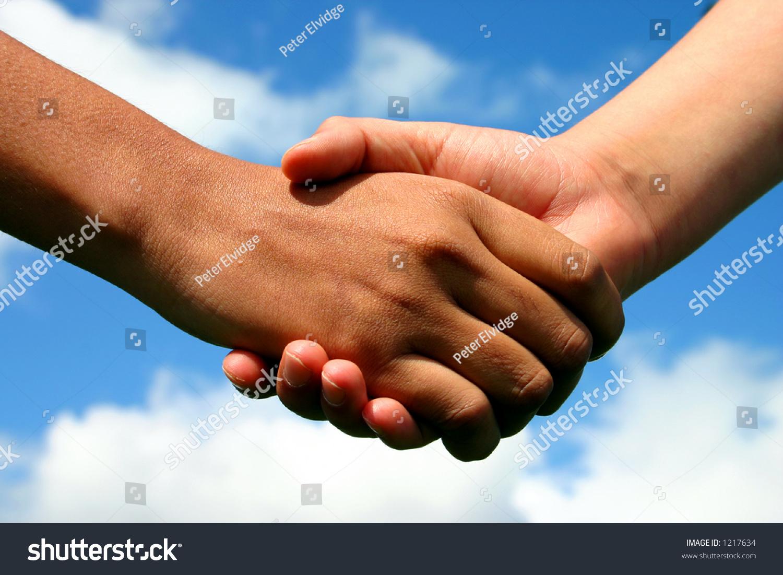 Handshake between indian lady white boy stock photo 1217634 a handshake between an indian lady and white boy symbolising friendship across gaps of race biocorpaavc