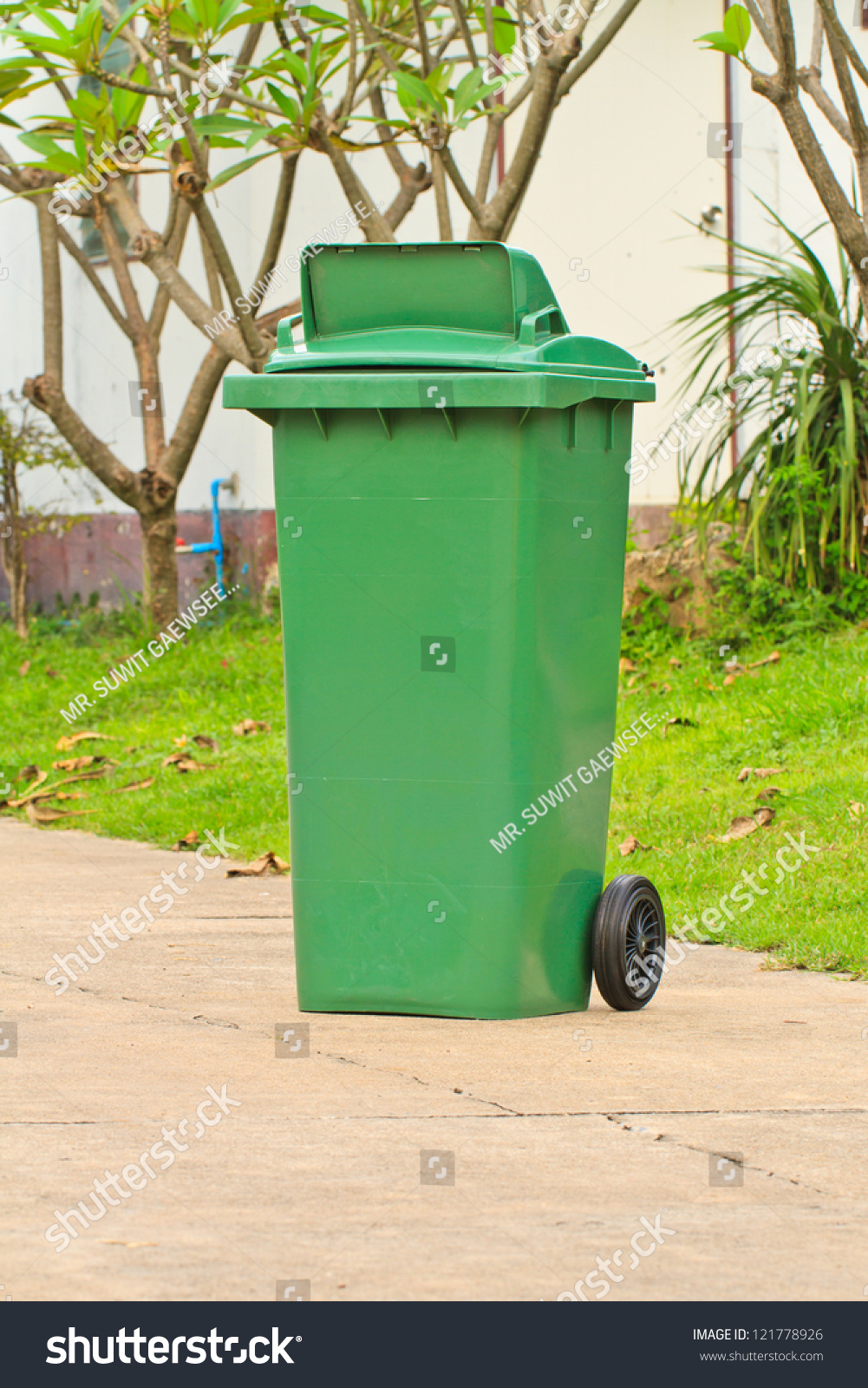 Green garbage bin with wheels on road stock photo 121778926 shutterstock - Rd rubbish bin ...