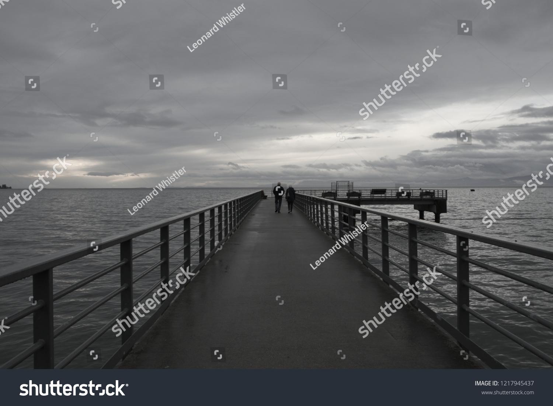 stock-photo-a-walk-along-a-pier-during-a