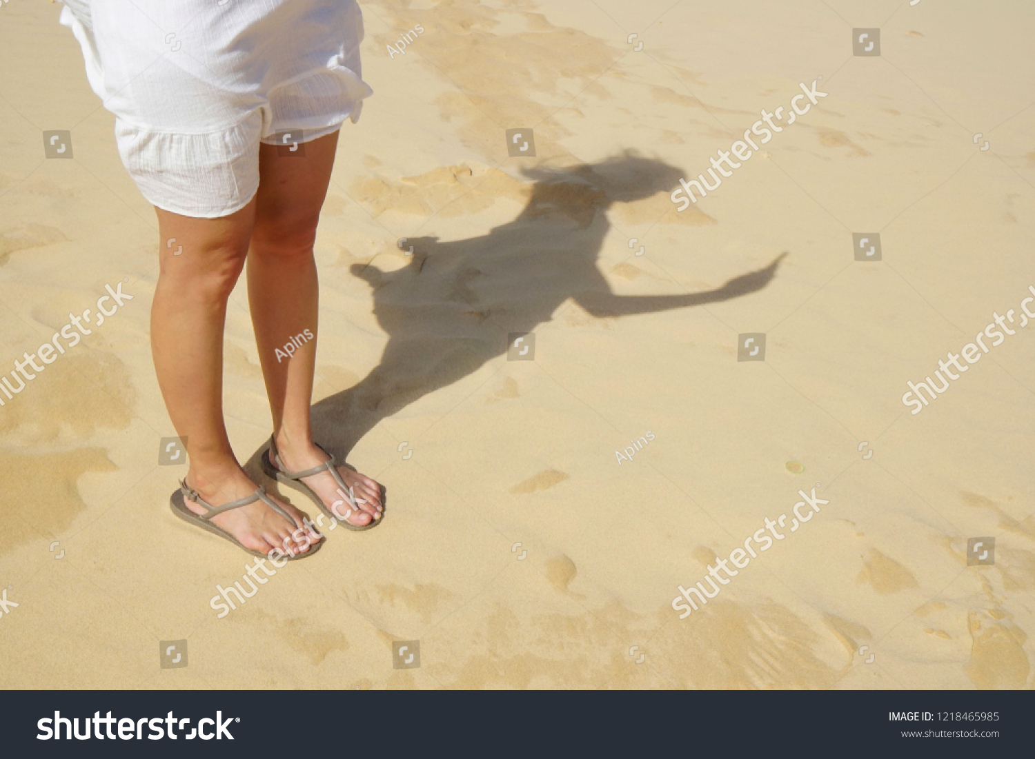 7d74cff4e woman s leg wearing white dress and sandal standing on desert reflect  shadow in selfie photo acting