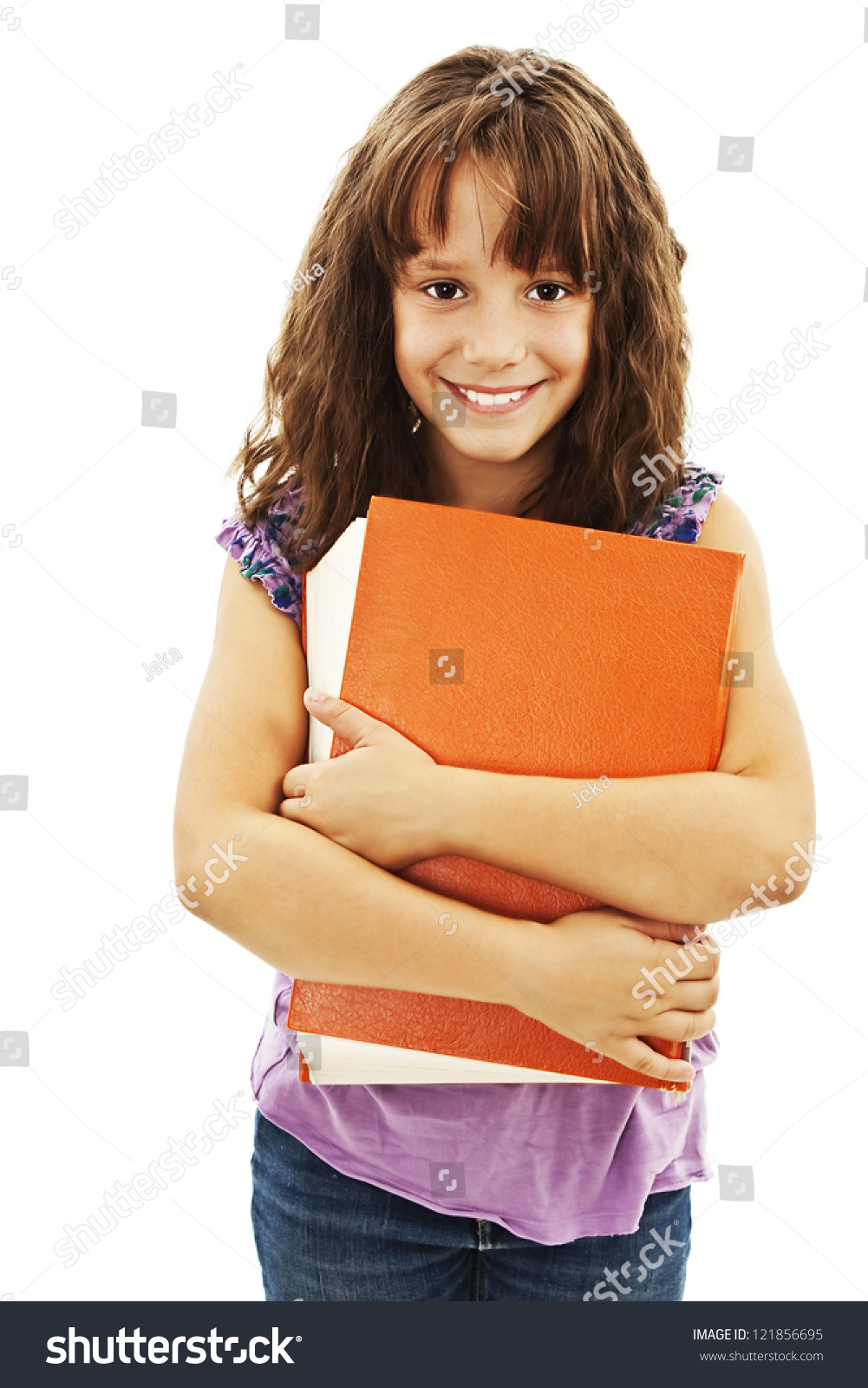 Little girl holding a big book. Isolated on white background