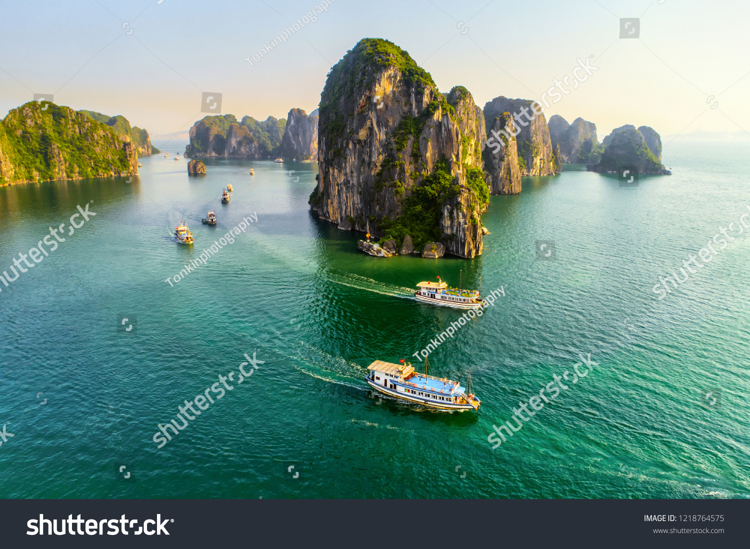 Aerial view floating fishing village and rock island, Halong Bay, Vietnam, Southeast Asia. UNESCO World Heritage Site. Junk boat cruise to Ha Long Bay. Popular landmark, famous destination of Vietnam #1218764575