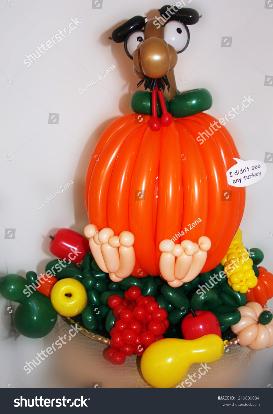 cc8ff14caff43 Funny balloon turkey in disguise on tray of food for Thanksgiving display