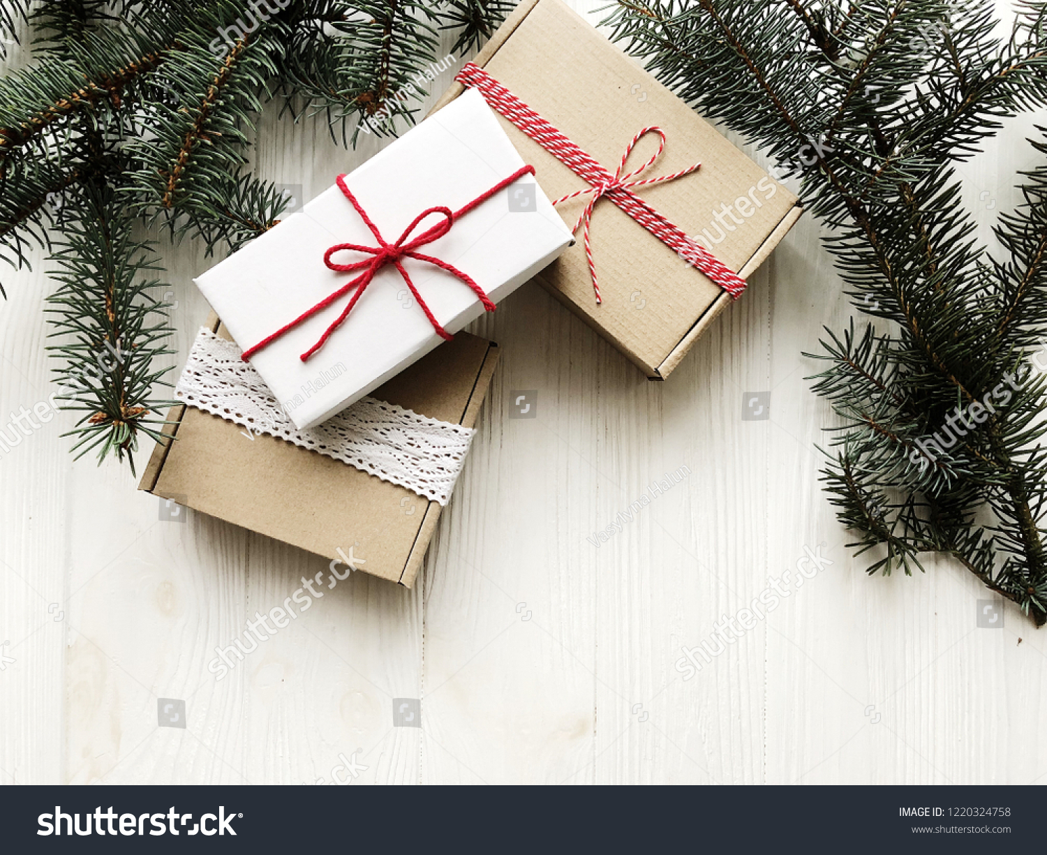 Christmas gifts packages on wooden table. Packing design. Place for your text. Pine & Christmas Gifts Packages On Wooden Table Stock Photo (Edit Now ...
