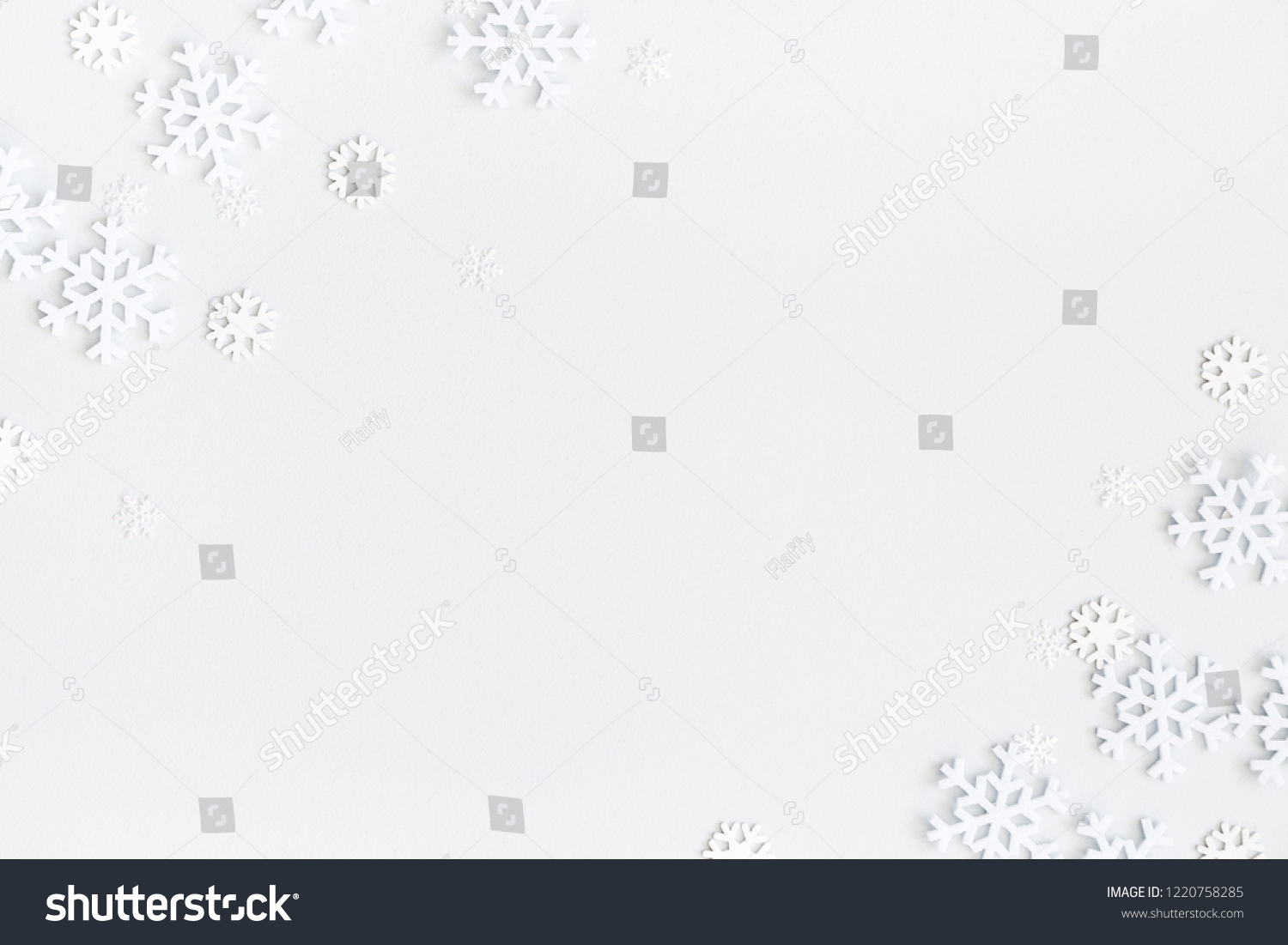 Christmas composition. Christmas frame made of snowflakes on pastel gray background. Winter concept. Flat lay, top view, copy space #1220758285