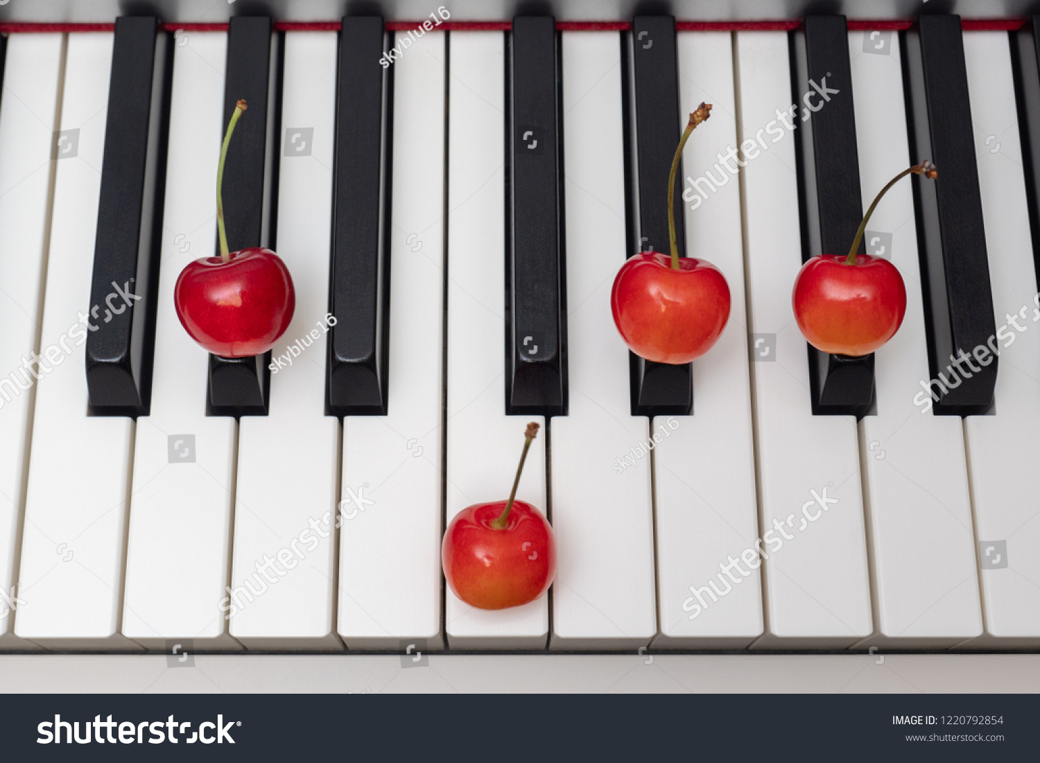 Piano Chord Shown By Cherries On Stock Photo Edit Now 1220792854