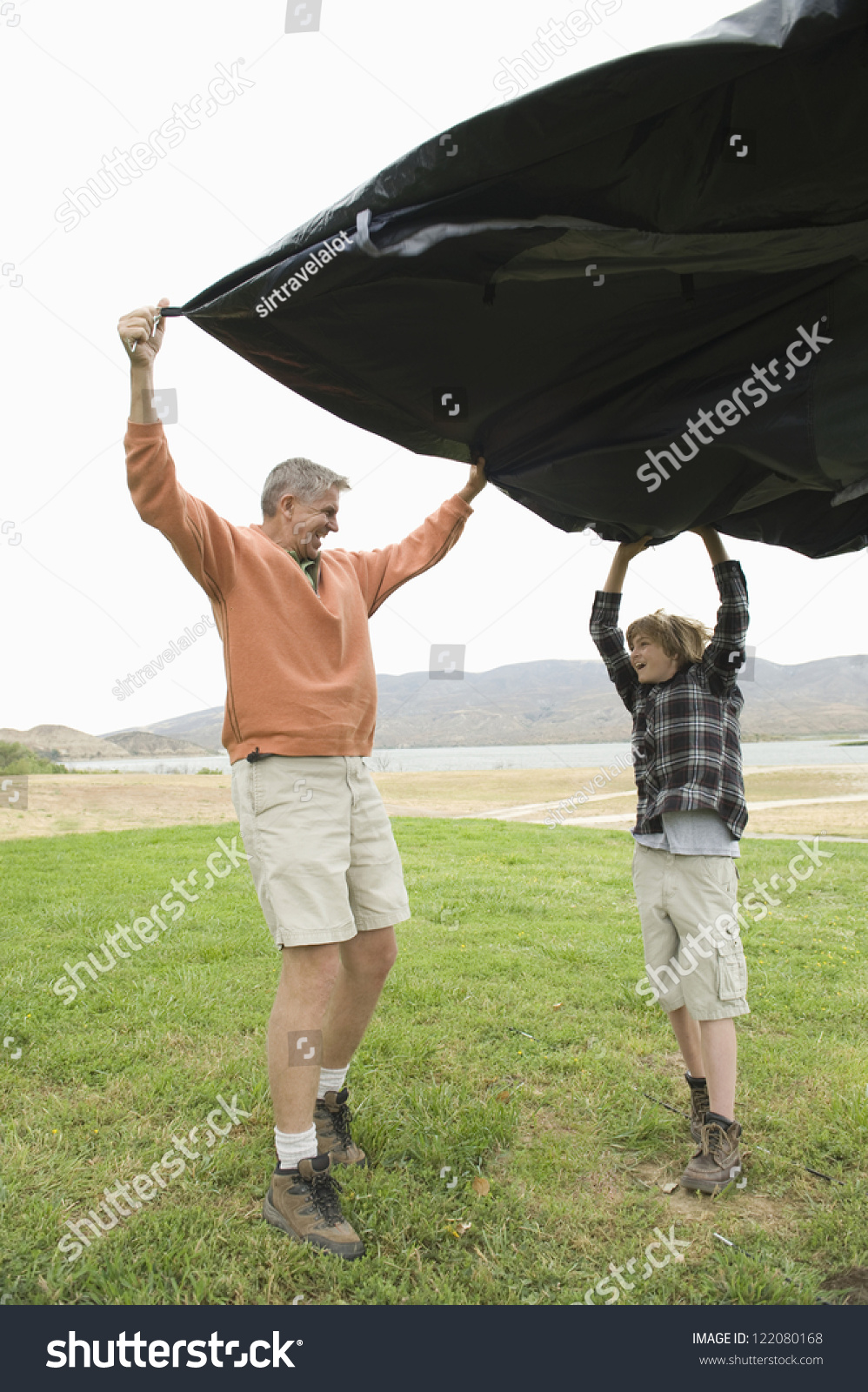 Full length of happy Caucasian father and son with tent holding tent cloth in garden & Full Length Happy Caucasian Father Son Stock Photo 122080168 ...