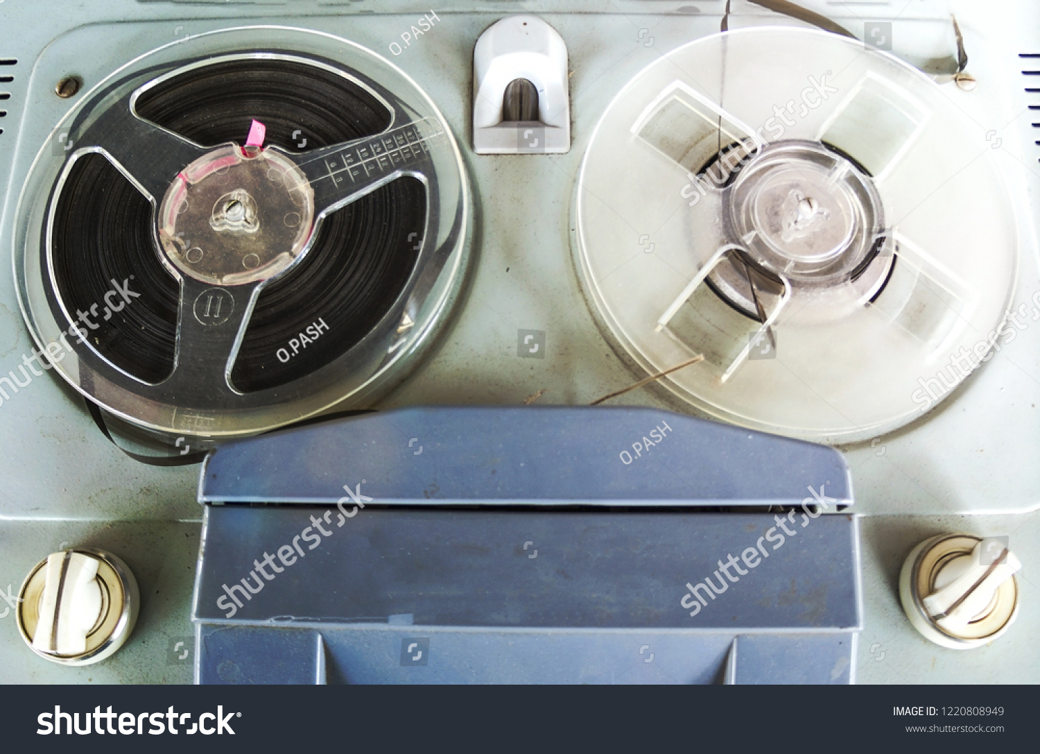 Old vintage player of reels. The antique Reel-to-Reel Tape Recorder without spools close-up #1220808949