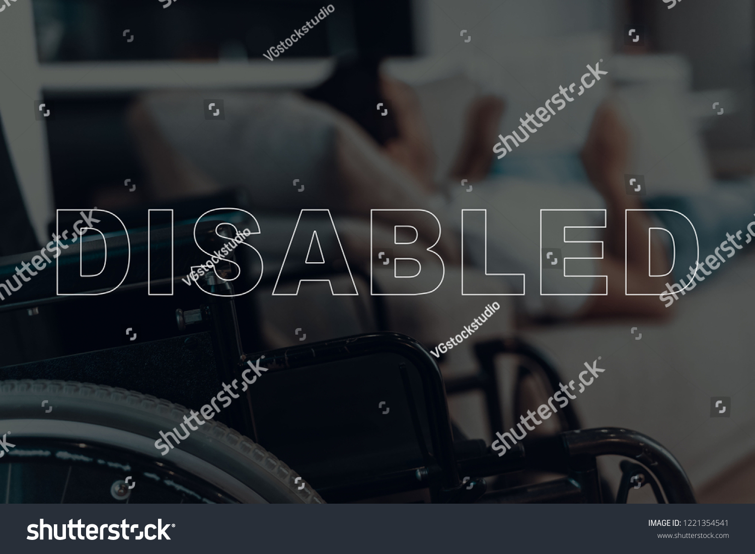 Disabled lying on sofa wheelchair on background of man man reading something