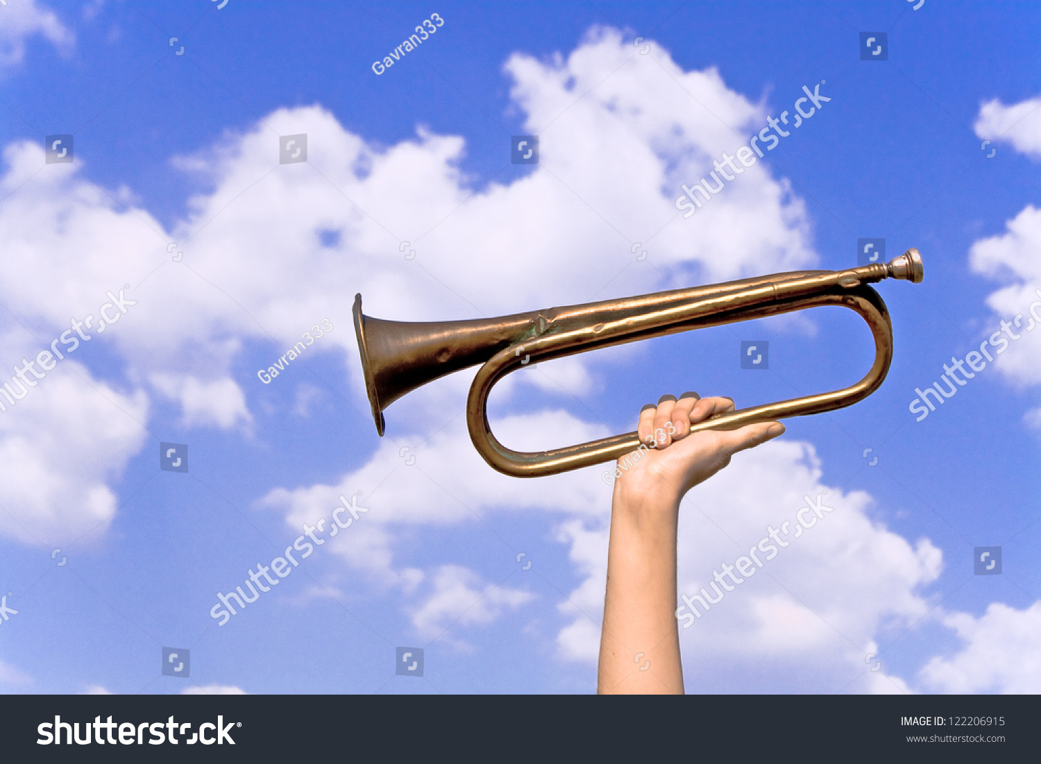 Old Army Trumpet Hand Over Blue Stock Photo 122206915