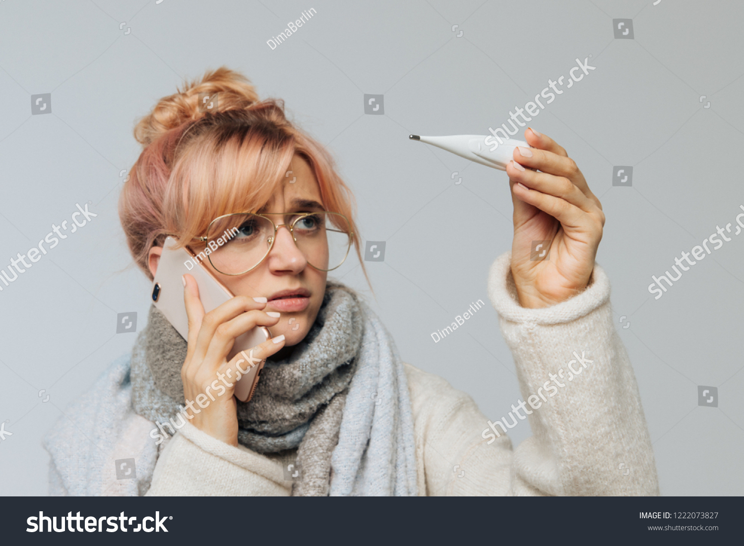 fae4d78fda8 Closeup portrait of European cute unhealthy woman in glasses caught cold and  looking at thermometer. Sick young blonde female in scarf feeling bad