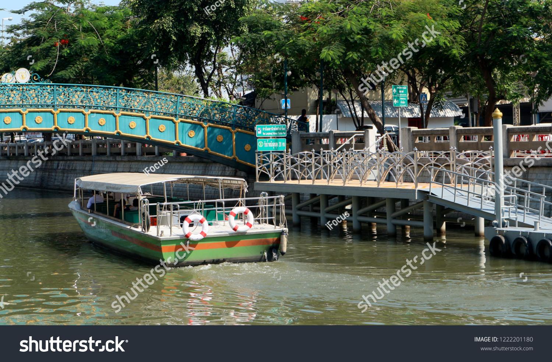 BANGKOK, THAILAND - NOVEMBER 4, 2018: Flat-bottom passenger boat on Khlong Phadung Krung Kasem on November 4, 2018 in Bangkok, Thailand.
