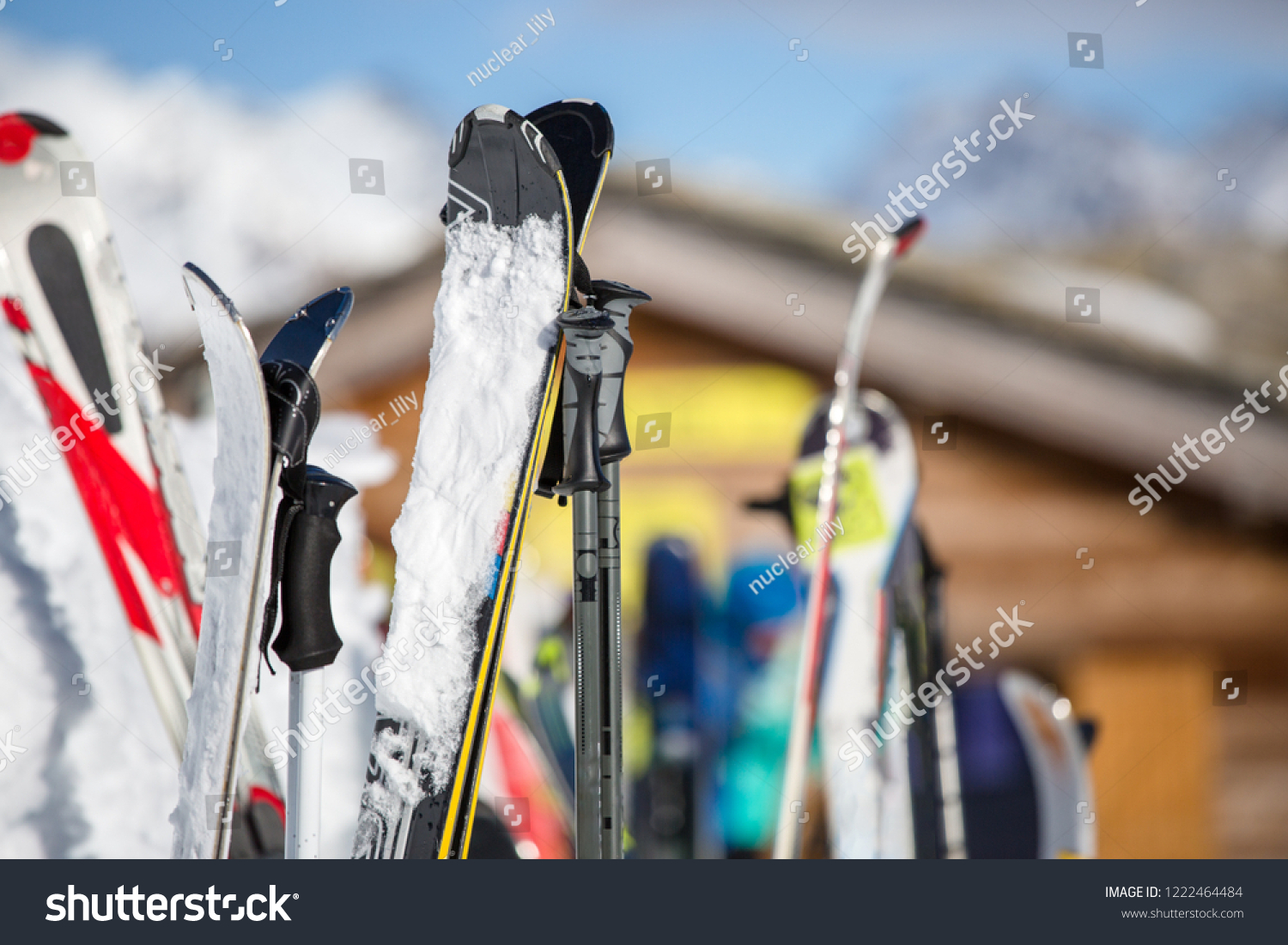 Image of multi-colored skis in snow at winter resort in afternoon. #1222464484