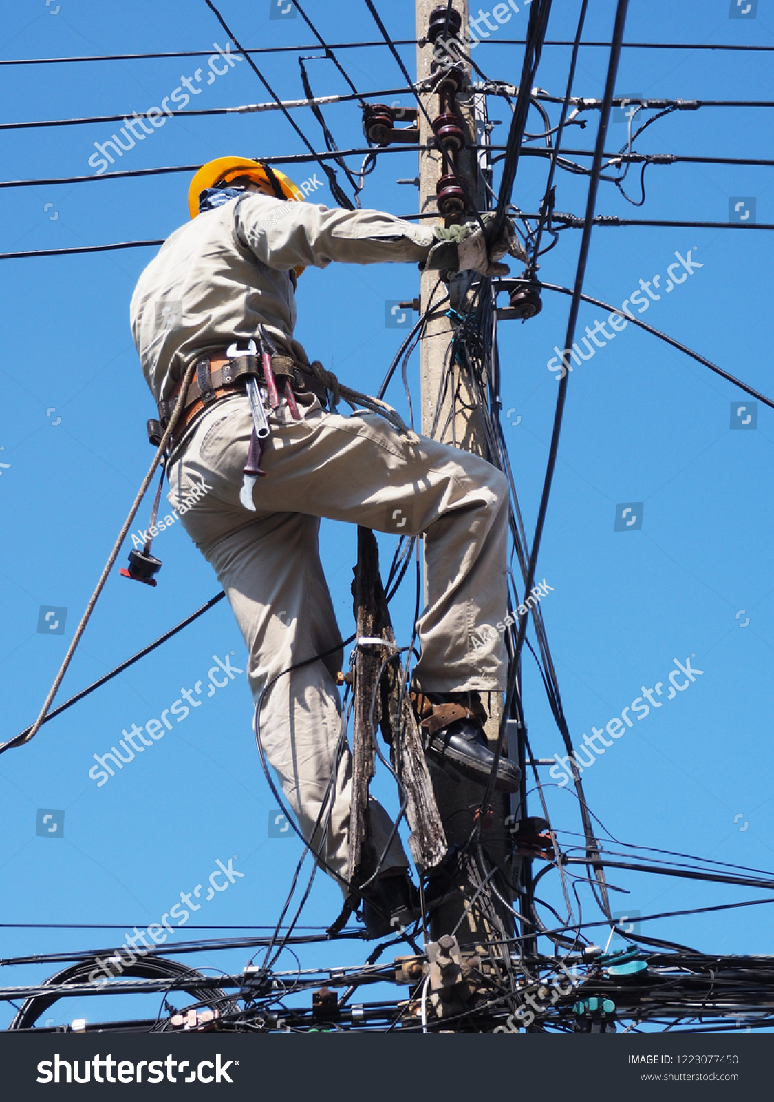 Electricians Wiring On Top Power Poles Stock Photo Edit Now 1223077450