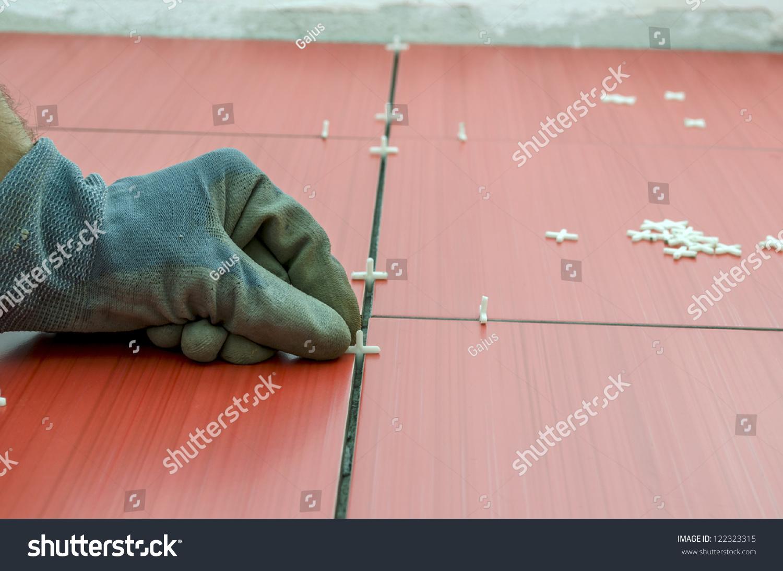Closeup Handyman Placing Tile Spacer Between Stock Photo Edit Now