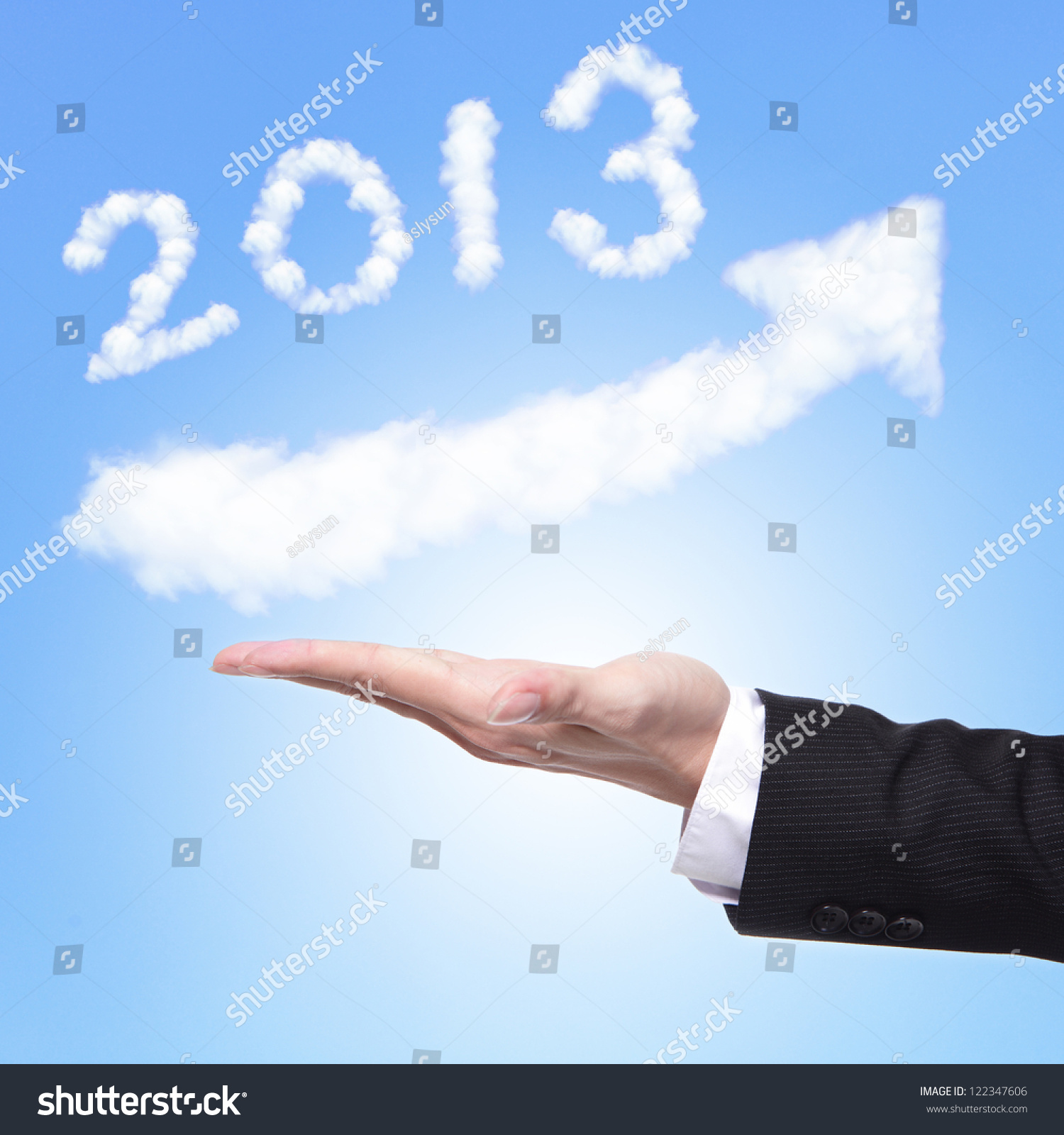 Technology Management Image: Hand Of Business Man Holding Happy New Year 2013 (White