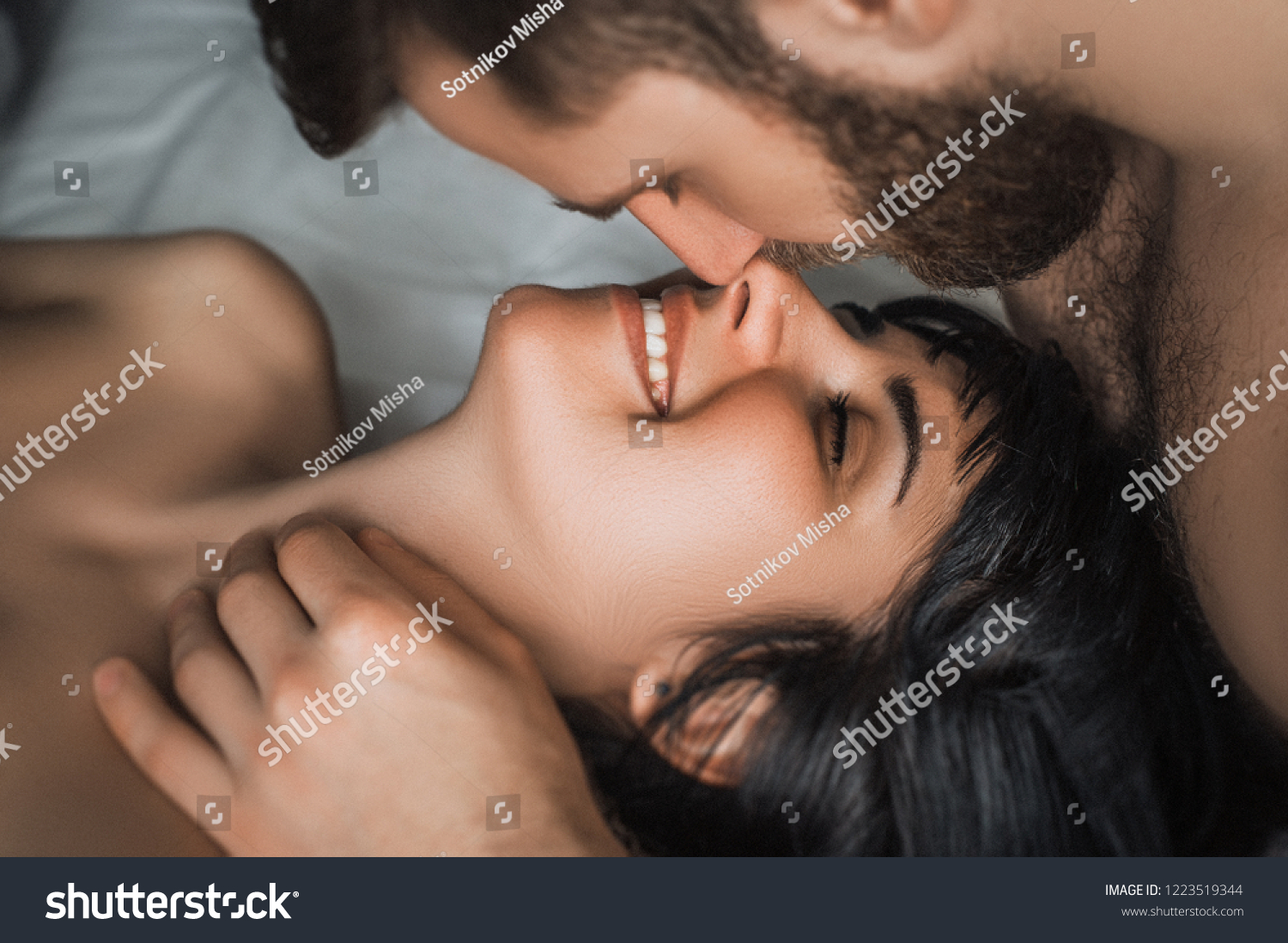 a guy and girl kissing