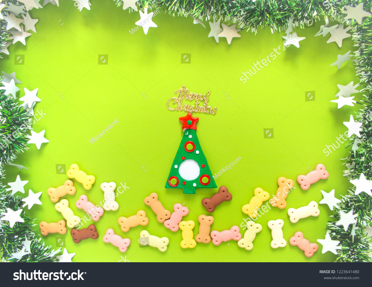 dog biscuits dog snack or dog chew in christmas and new year themes on green