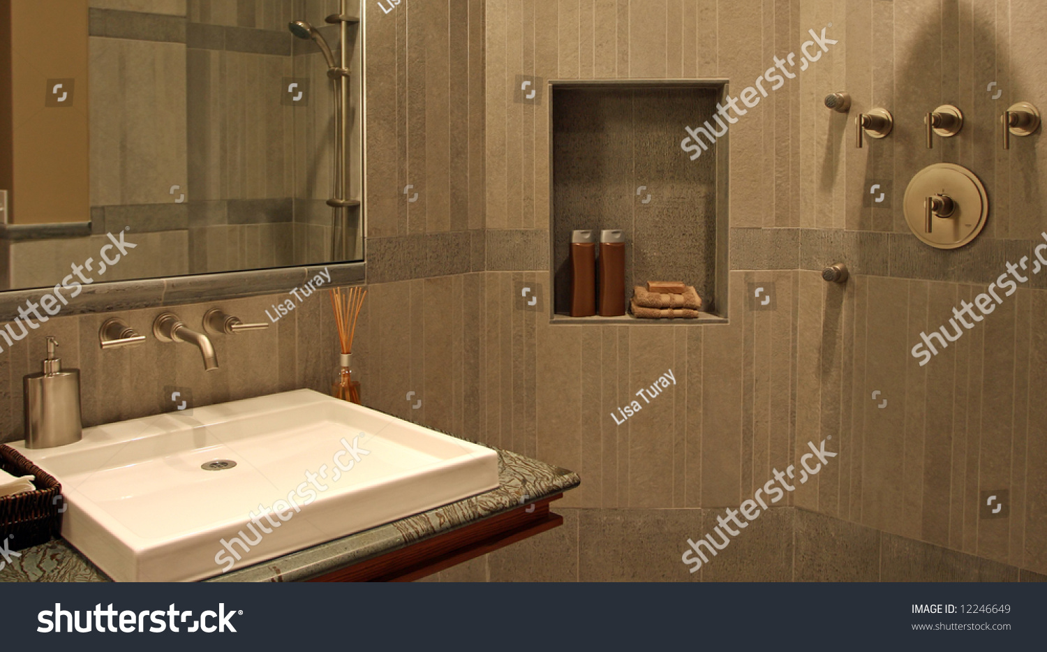 A very modern bathroom with stone walls and a flat sink for Very modern bathrooms