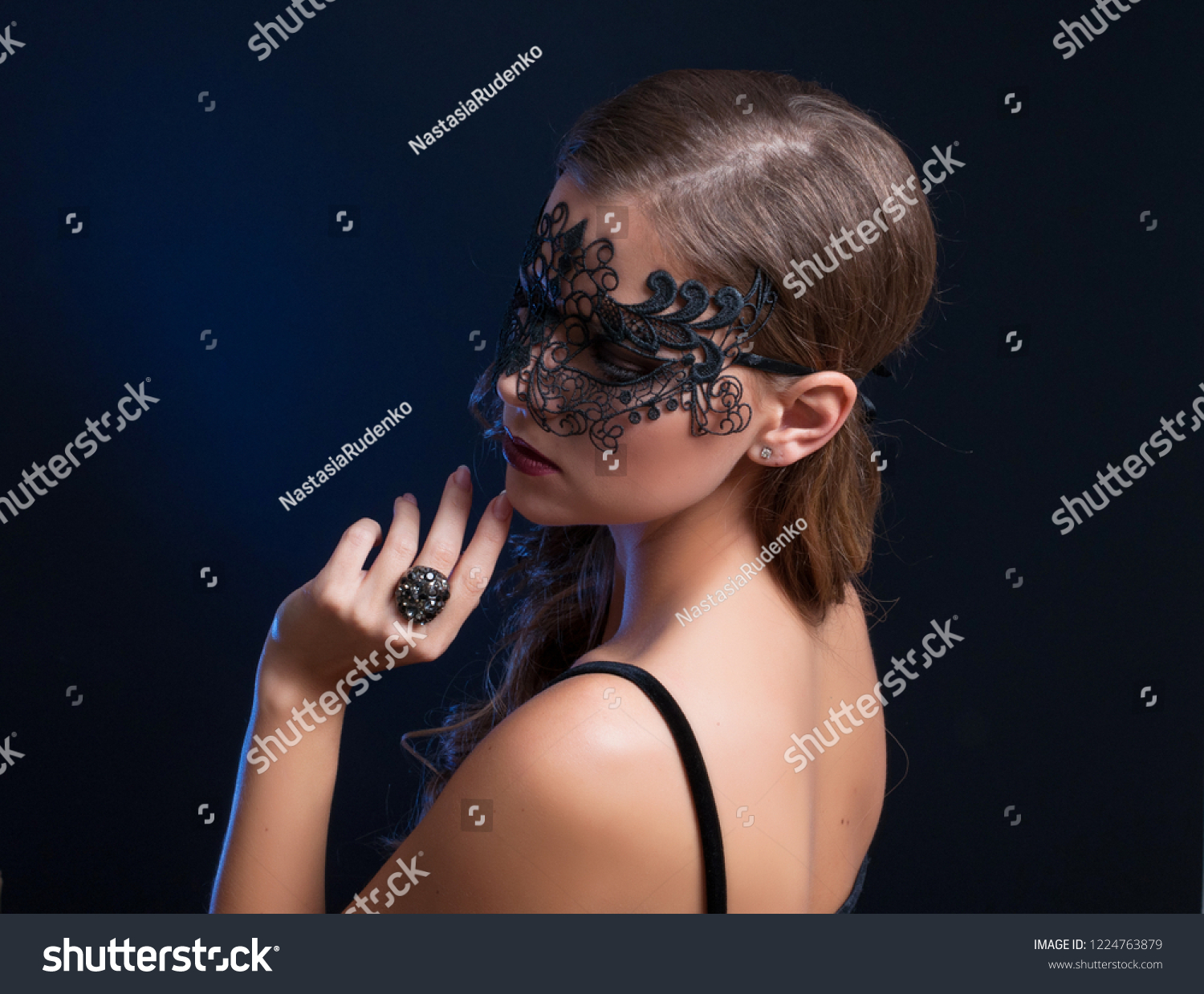 Portrait of young beautiful sexy woman with erotic style black lace mask
