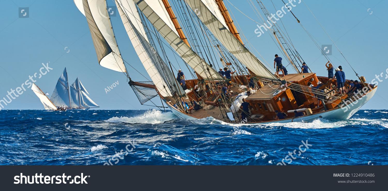 Sailing ship race. Classic yacht under full sail at the regatta #1224910486