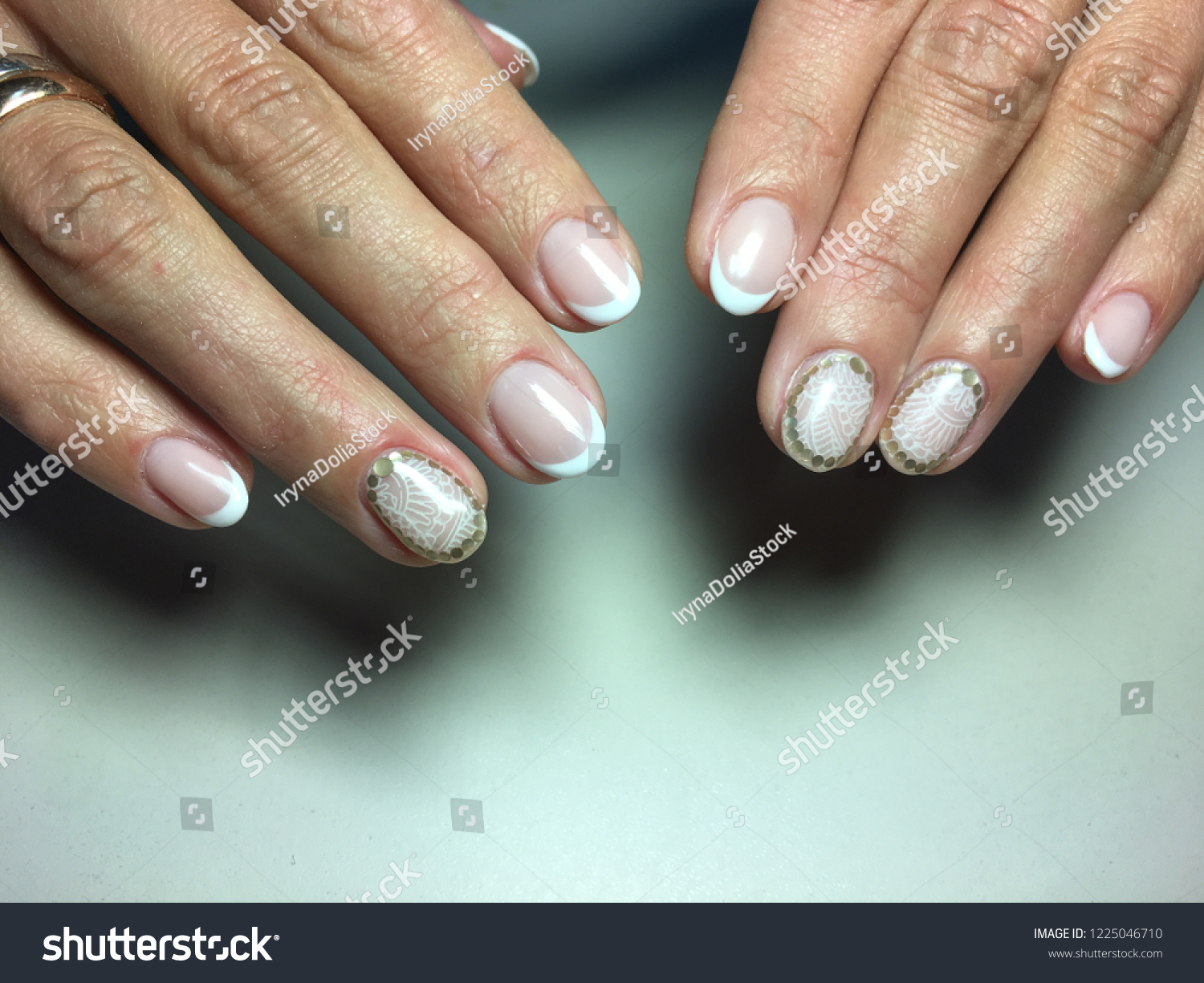 delicate french manicure on long nails with white design - Delicate French Manicure On Long Nails Stock Photo (Edit Now