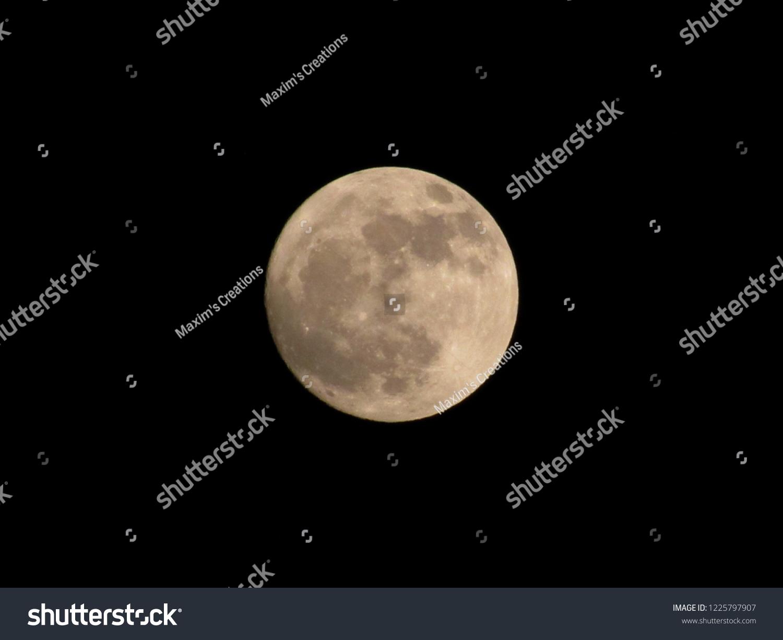 stock-photo-full-moon-distanced-at-night