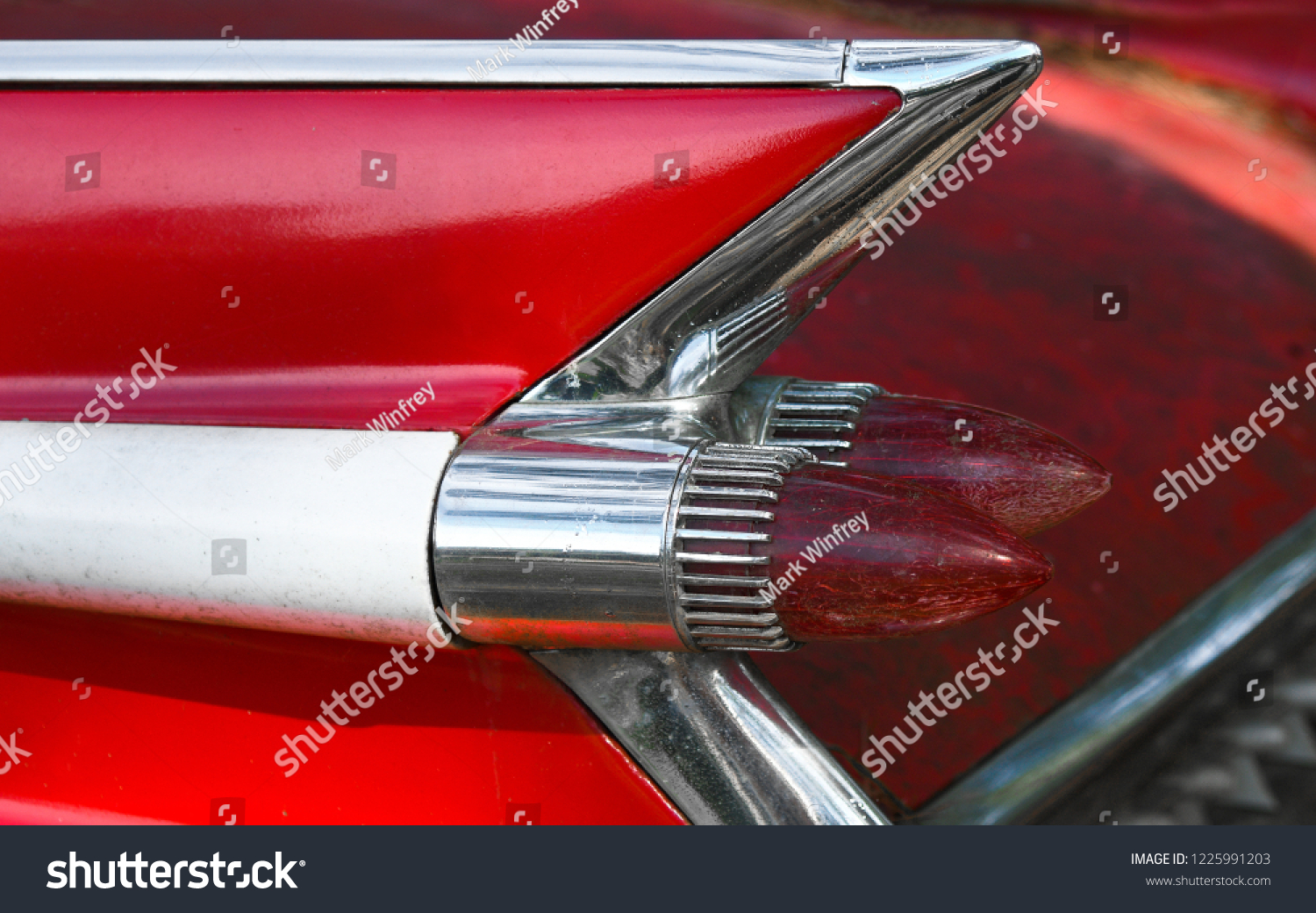 stock-photo-retro-fin-on-an-old-red-clas