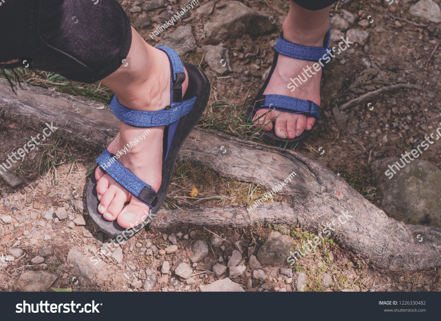 35021ee37f2 Traveler Feet in tourist sandals hiking in mountains Travel Lifestyle  adventure active summer vacations outdoor concept