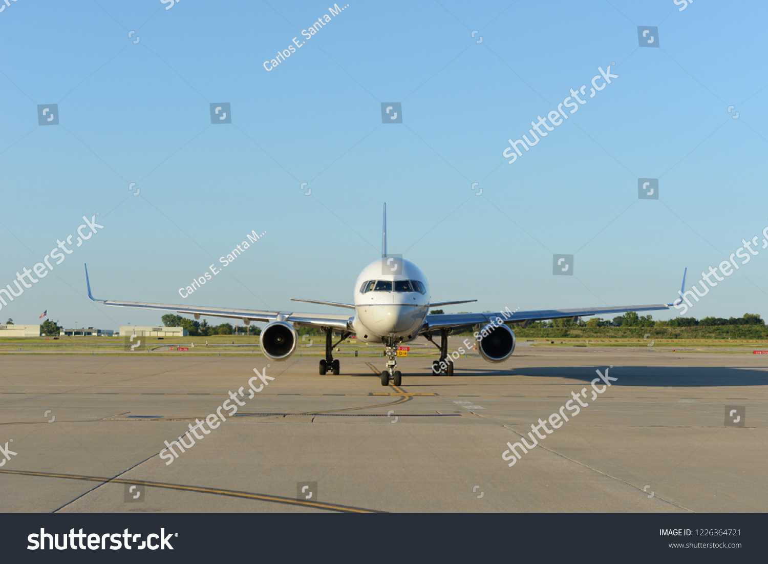 Commercial Aircraft On Tarmac On Sunny Stock Photo (Edit Now