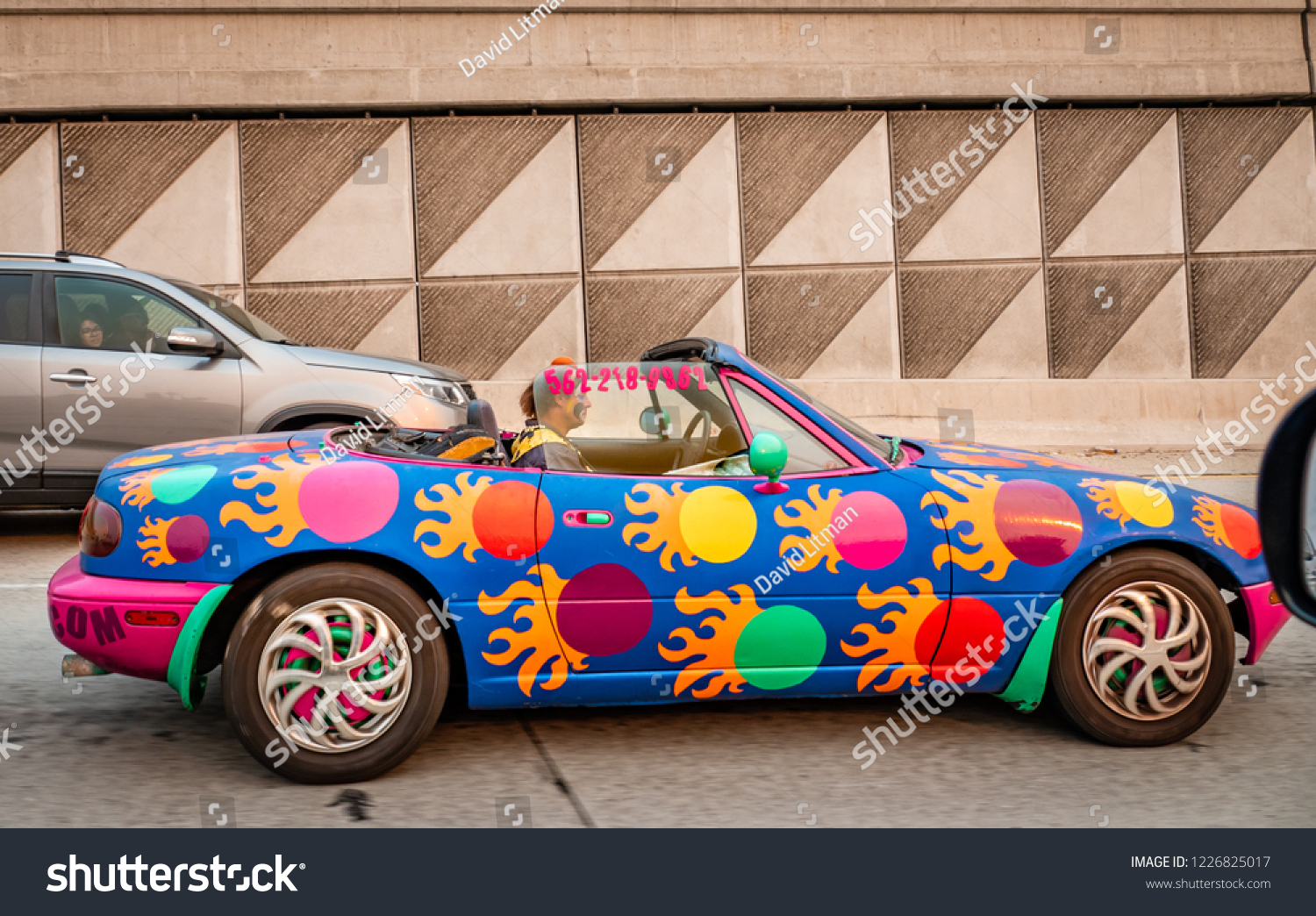 "Los Angeles, California - November 10, 2018: The ""California Clown"" drives a colorful decorated sports car to events such as birthday parties, company picnics, grand openings, preschools and day cares"