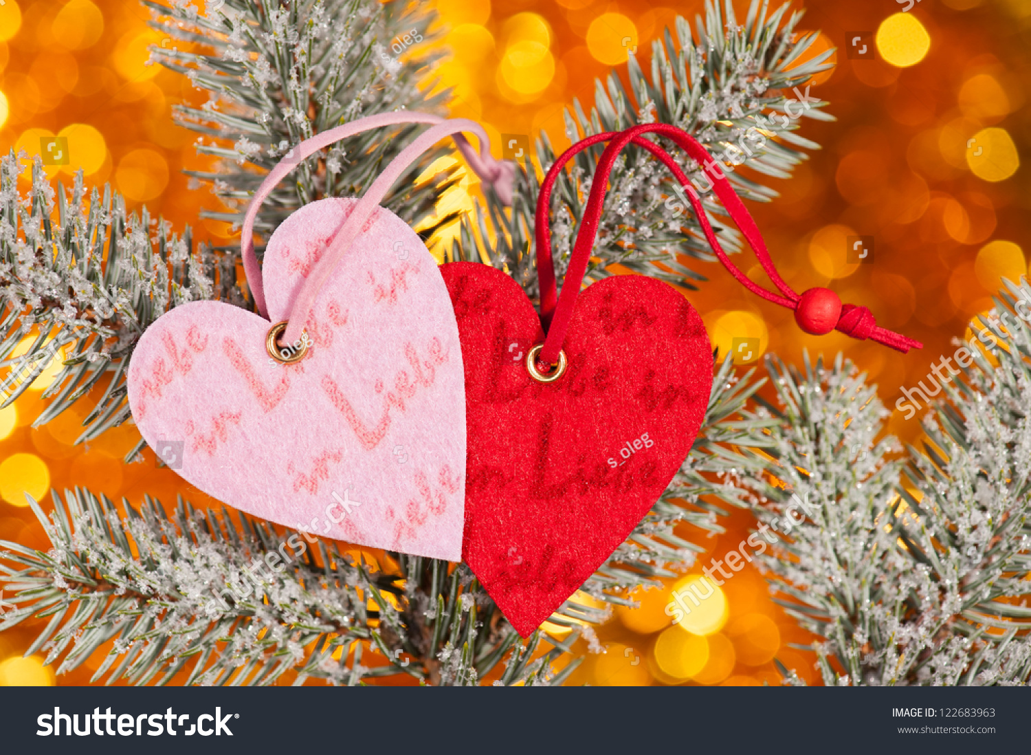 Two Hearts On Christmas Fir Tree Branch And Golden