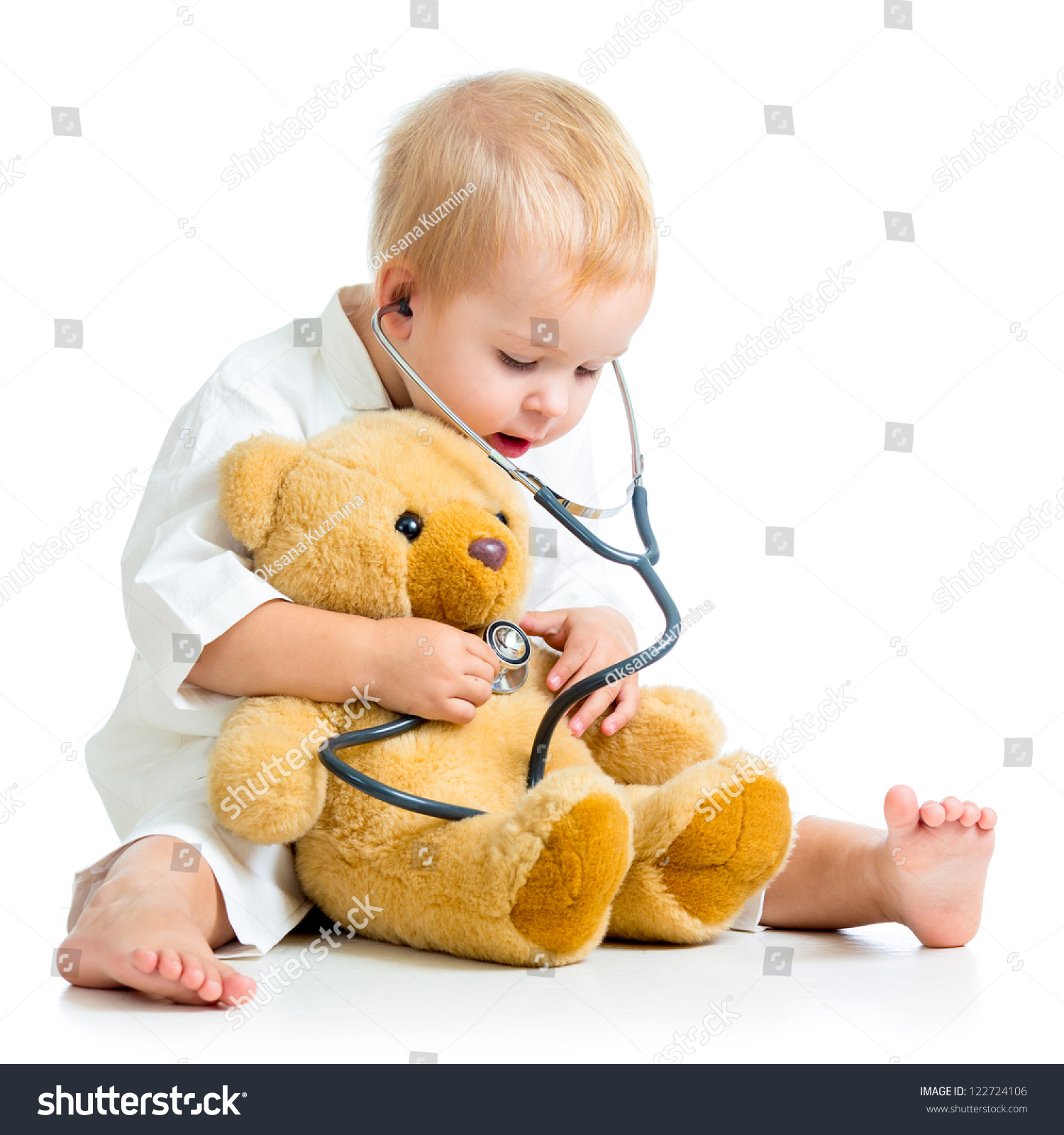 doctor kid Kid playing a doctor isolated on white Stock Photo
