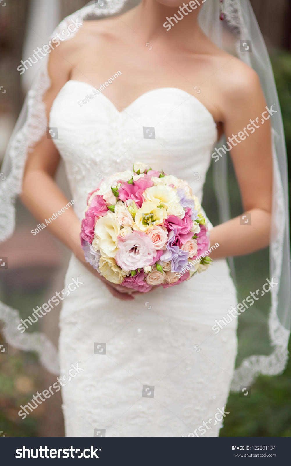 Bride holding beautiful wedding bouquet purple stock photo edit now bride holding beautiful wedding bouquet of purple pink yellow and white flowers slim izmirmasajfo