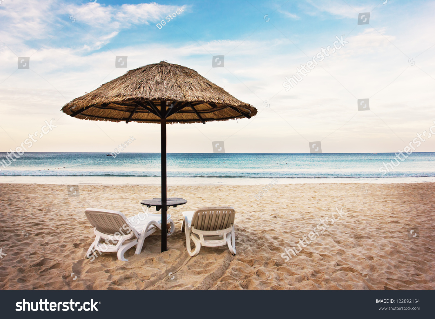 Seascape two chaise longues without people stock photo for Beach chaise longue