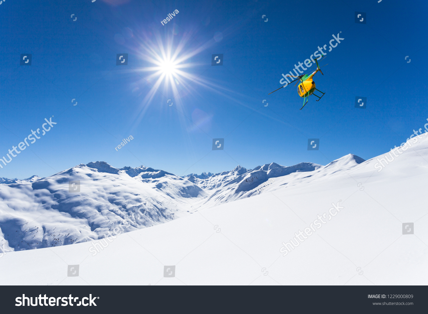 in flight over the snow-covered Alps #1229000809