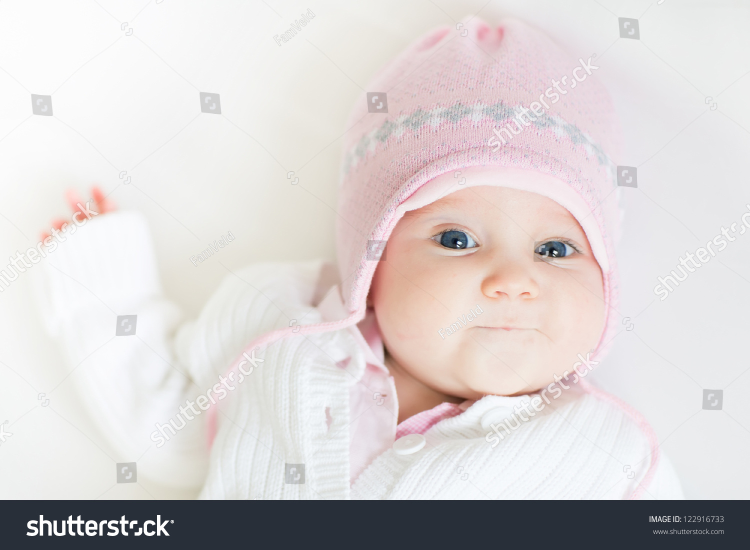 Sweet Baby Girl In A Pink Knitted Hat Stock Photo ...