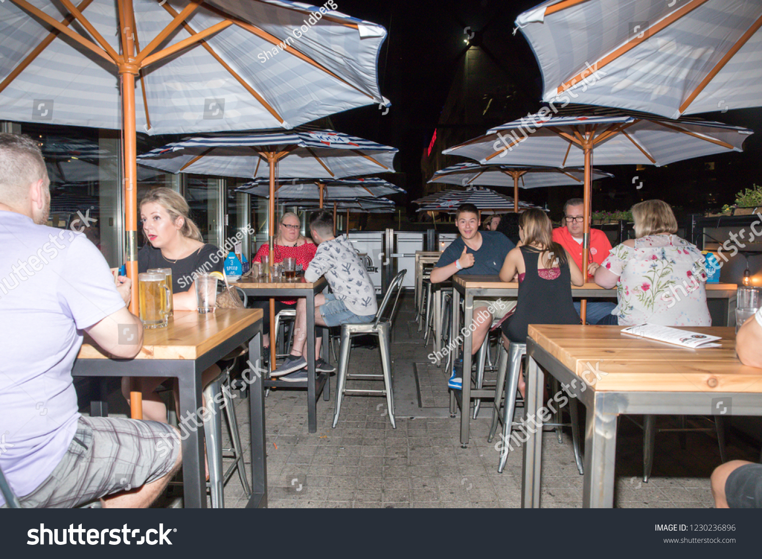Toronto ontario canada june 15 2018 people have drinks and food