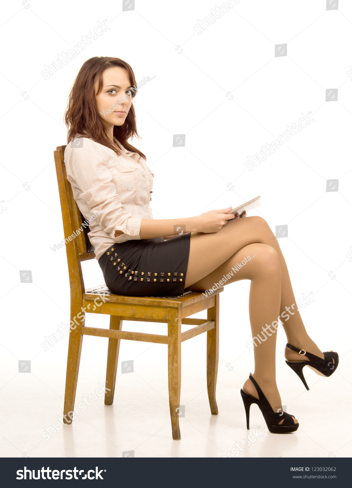 Related Keywords amp Suggestions for office crossed legs : stock photo attractive woman with crossed legs sitting on wooden chair isolated on white 123032062 from keywordteam.net size 1154 x 1600 jpeg 366kB