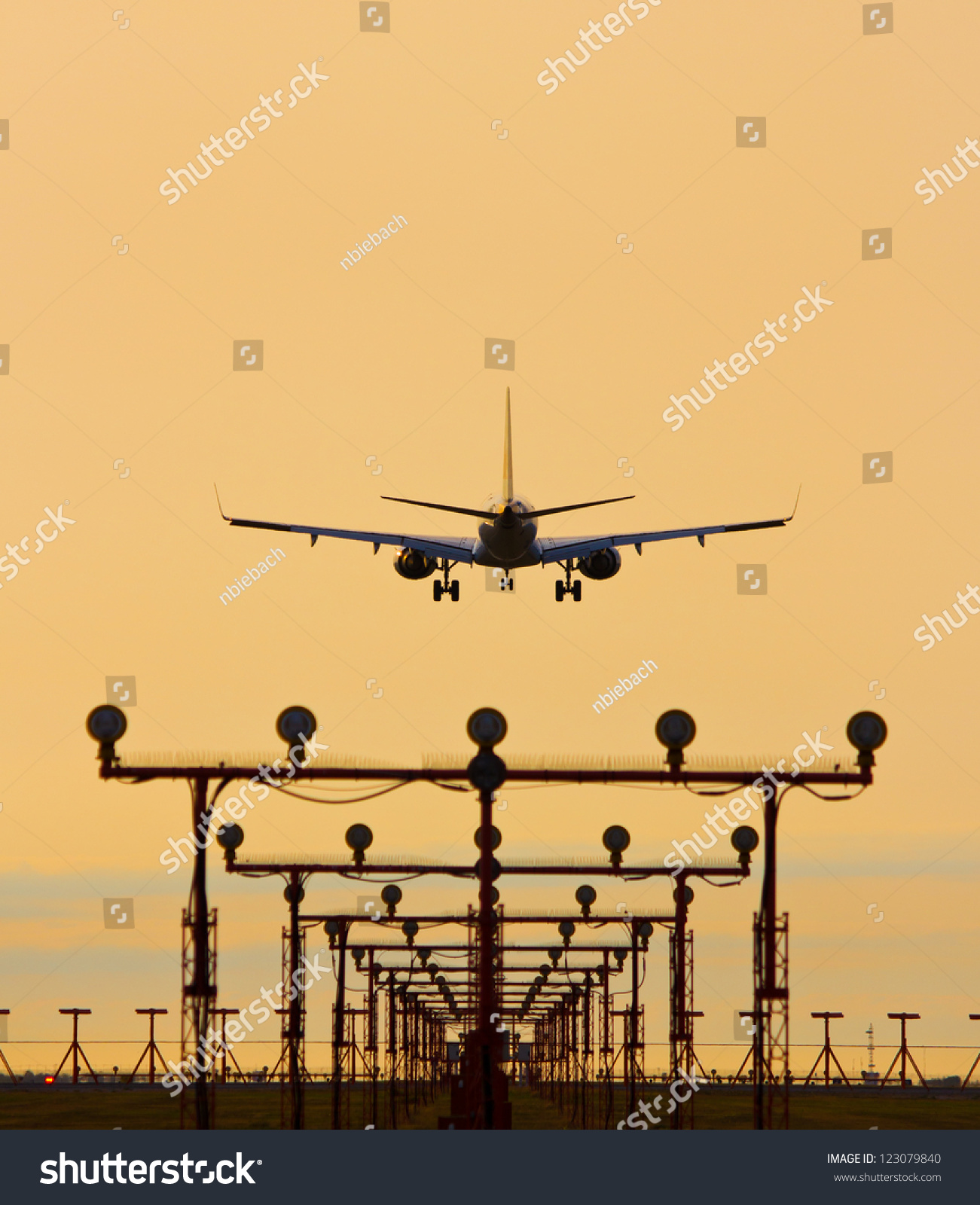 Airplane Landing Sunset Landing Lights Foreground Stock