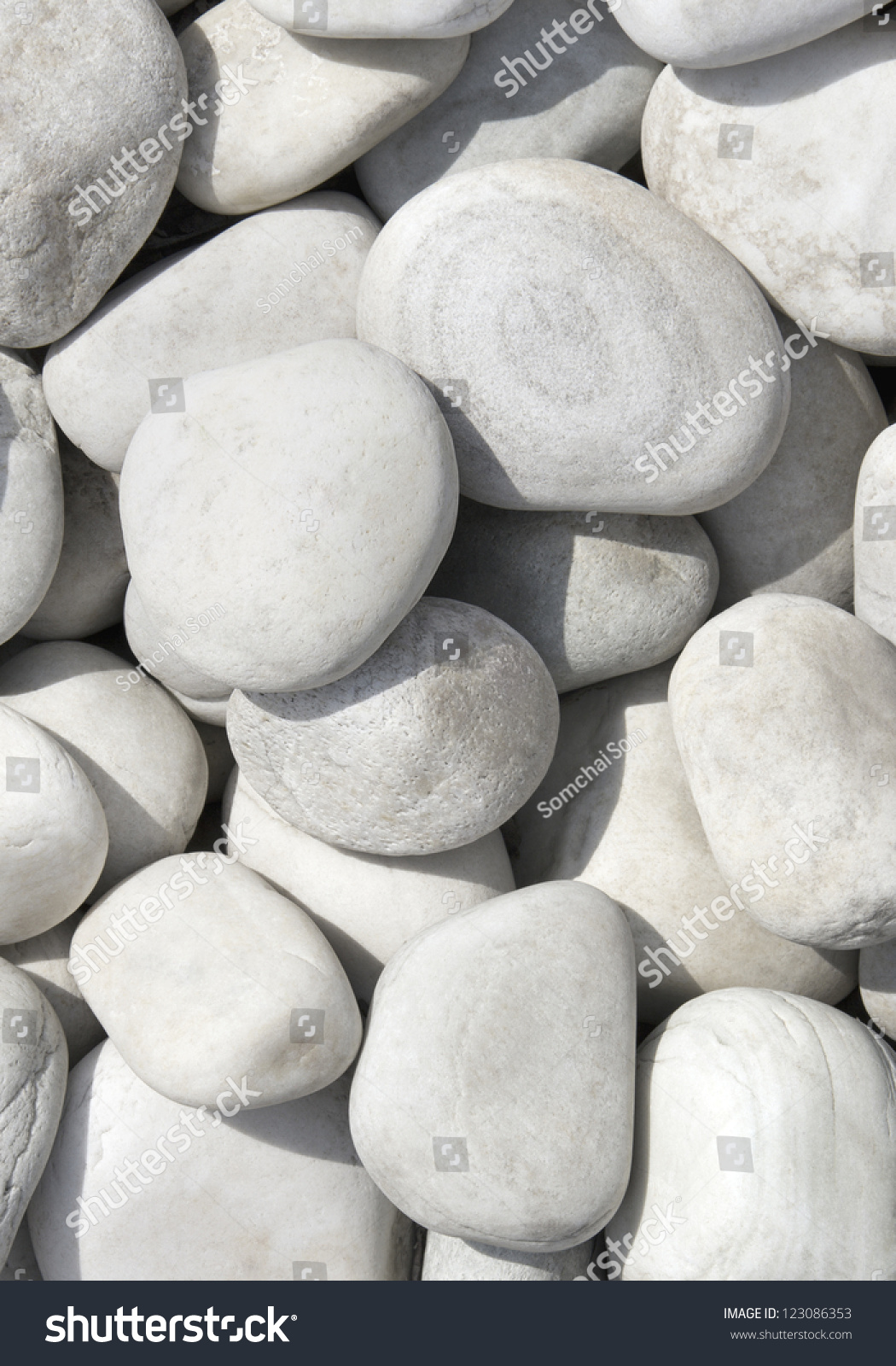 Smooth shaped white stones surface texture background stock photo - Pile Of White Stones For Background Or Texture Close Up Of The White Pebbles
