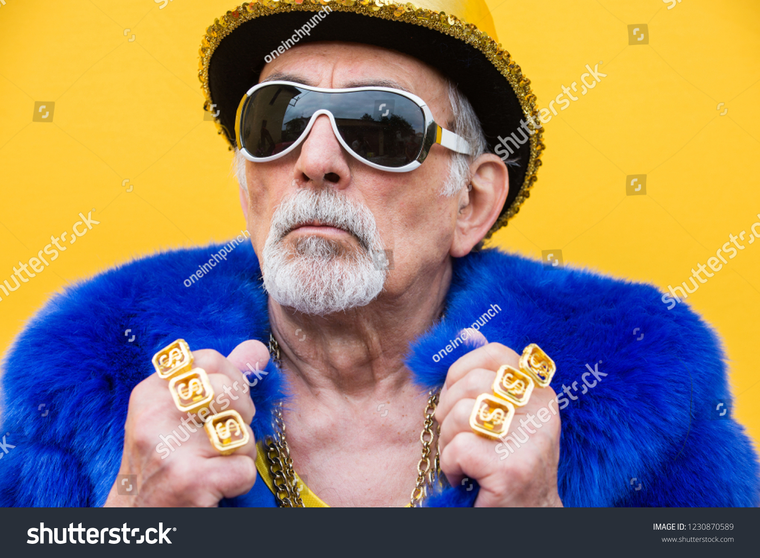 Funny and extravagant senior man posing on colored background - Youthful old man in the sixties having fun and partying #1230870589