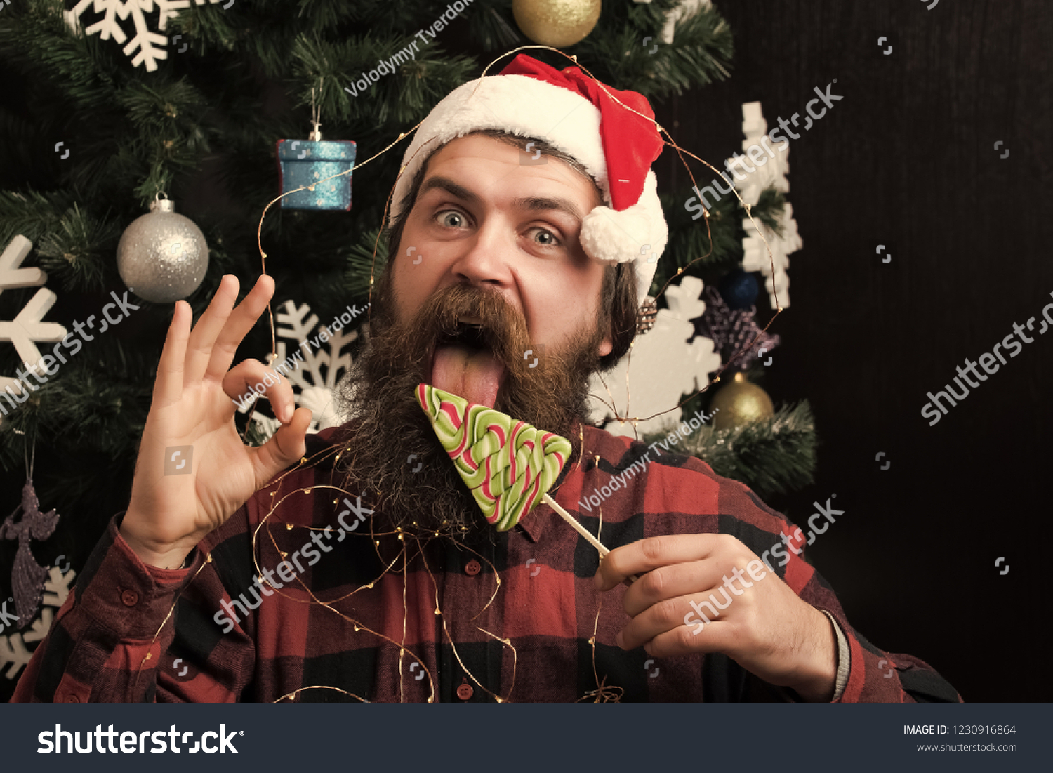 santa claus man in hat at decoration. Winter holiday and xmas. Party  celebration and
