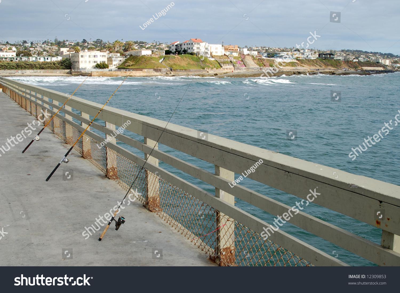 Fishing poles on pier ocean beach san diego california for Pier fishing san diego