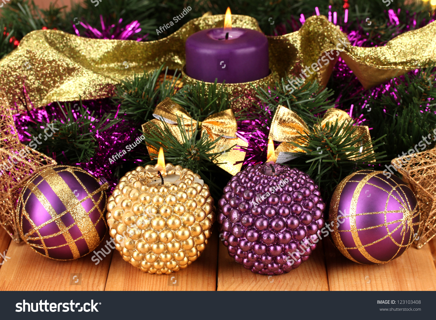 christmas composition with candles and decorations in purple and gold colors on wooden background ez canvas