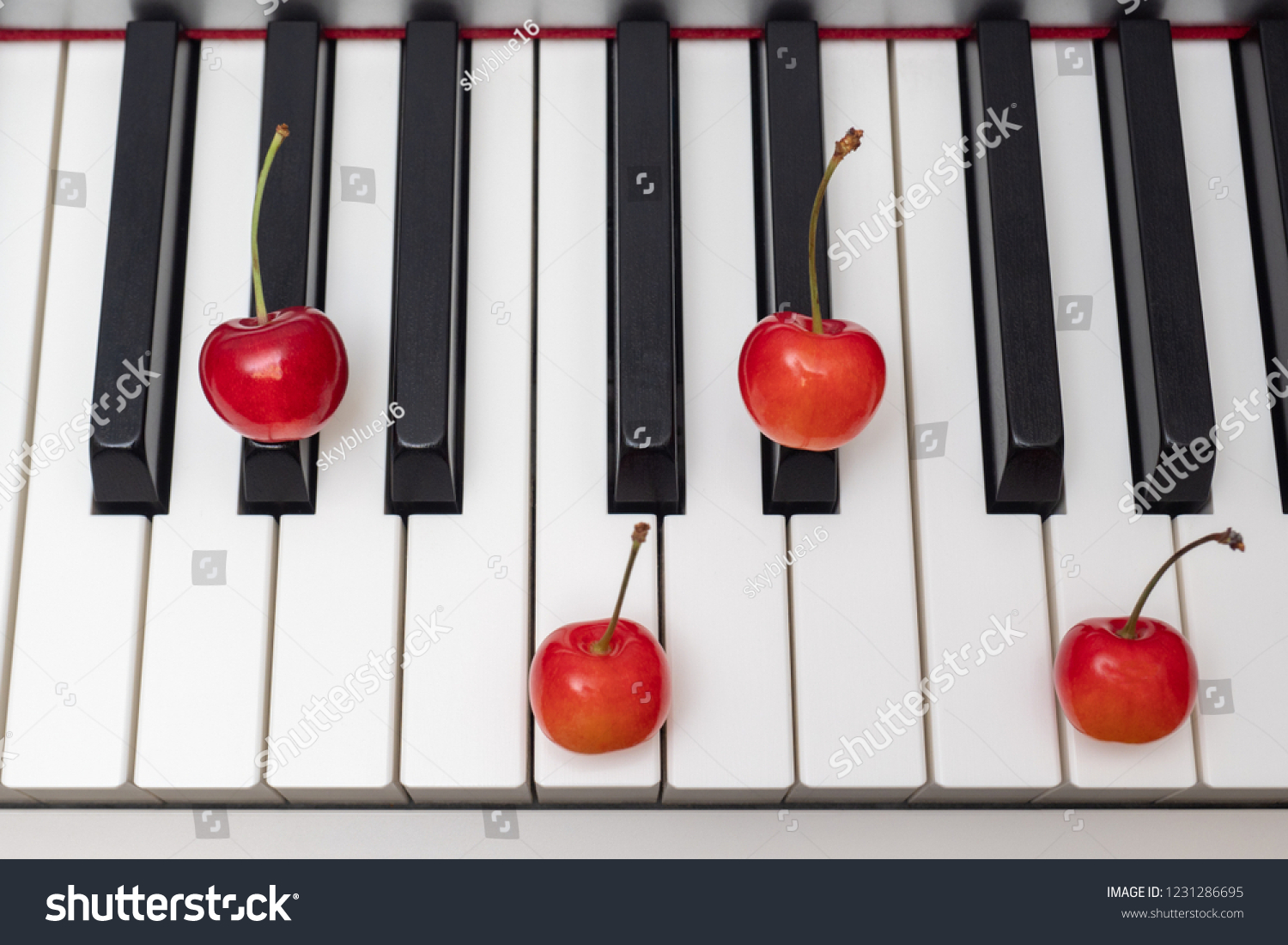 Piano Chord Shown By Cherries On Stock Photo Edit Now 1231286695